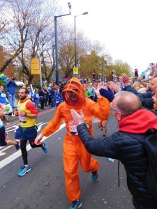 Ian Wallace from Quince Honey Farm running the London Marathon in orange BJ Sherriff beekeeping suit